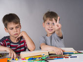 Brothers as pupils — Stock Photo