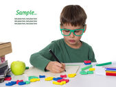Young boy doing his homework, place for ad — Stock Photo