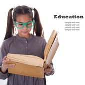 Girl with big book, education concept — Stock Photo