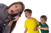 Shocked girl reporting fight between boys — Stock Photo