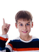 Happy boy pointing up, isolated on the white background — Stock Photo