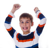 Happy boy raising his hands like a winner — Stock Photo
