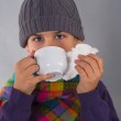 Boy drinking tea and wiping his nose — Stock Photo