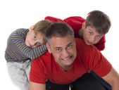 Spoiled children on their father's back, challeges od parenting — Stock Photo