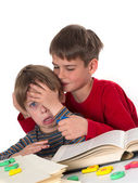 Boy calms his younger brother — Stock Photo