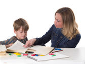 Mother teaching her child — Stock Photo