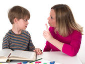 Young pupil doesn't want to learn, he confronts his mother who is threatening him — Stock Photo