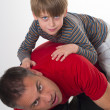 Spoiled child on his father back — Stock Photo #45928465