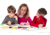 Mother reading to her sons — Stock Photo