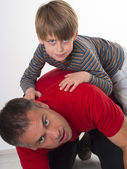 Spoiled child on his father back — Stock Photo