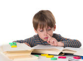Hardworking schoolboy — Stock Photo