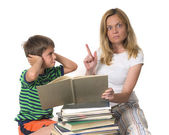 Angry mother trying to teach her son while he is confronting — Stock Photo