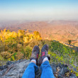 Shoes of a man on mountain — Stock Photo
