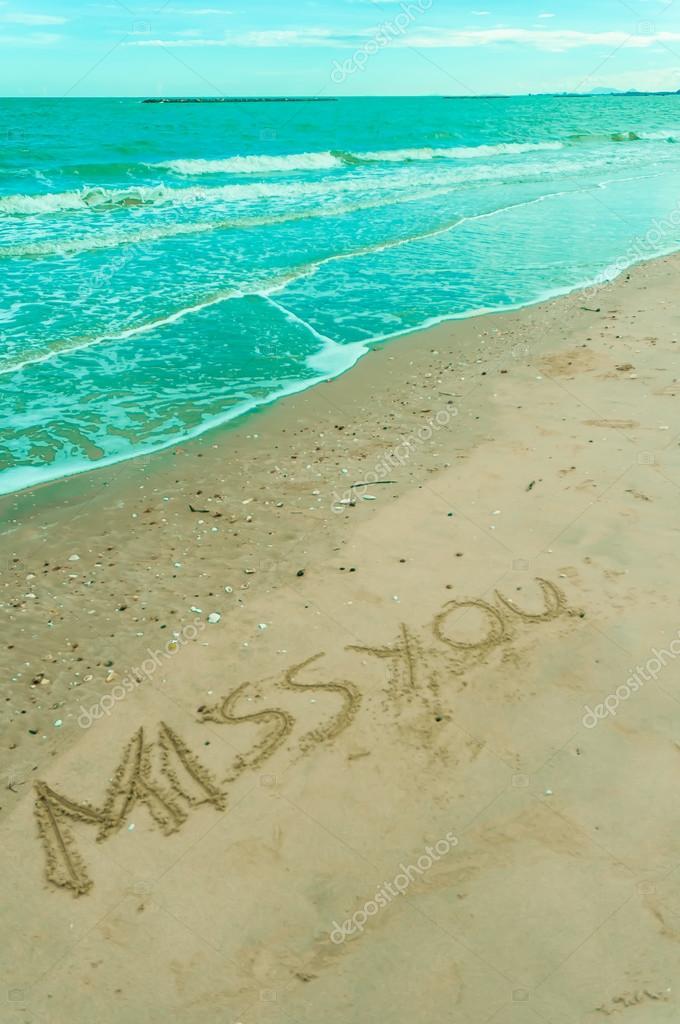 Escrito en la arena en una playa de extra ar fotos de for Arena de playa precio