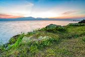 Sunset behind mountain in lagoon — Stock Photo