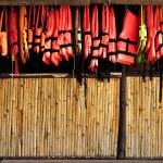 Bamboo wall hanging a life jacket. — Stock Photo #31312941
