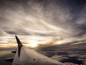 Airplane travel time is sunset — Stock Photo
