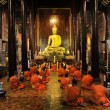 Постер, плакат: Buddhist monks pray and meditate every day evening : Wat Phan Ta