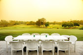 Table beside the golf course — Stock Photo