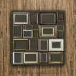 Antique frame on wood background — Stock Photo