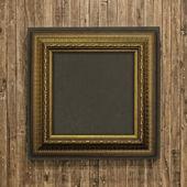 Antique frame on wood background — Stock Photo