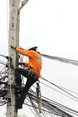 Electrician Man on electric poles. — Stock Photo