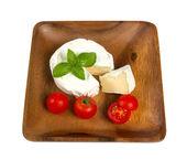 Camembert cheese and fresh cherry tomatoes — Stock Photo