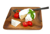 Camembert cheese and fresh cherry tomatoes — Stock Photo