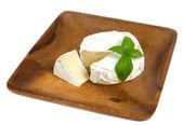 Camembert cheese and fresh basilic — Stock Photo