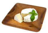Camembert cheese and fresh basilic — Stock Photo