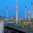 Oil Refinery factory at night - Stock Photo