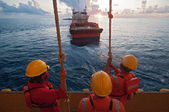The workers prepare jump to the boat. — Stock Photo