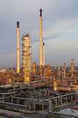 Oil Refinery factory at sunset — Stock Photo