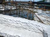 Sand bags help keep flood waters — Stock Photo