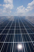 Solar cell over the blue sky and reflect the sun. — Stock Photo