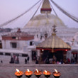 Sacred candles in front of Boudha Nath (Bodhnath) stupa in kathm — Stock Photo