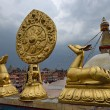 Golden brahma symbol in front of Boudha Nath (Bodhnath) stupa in — Stock Photo