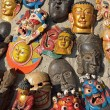 Masks, pottery,souvenirs, hanging in front of the shop, Bhaktapu — Stock Photo #25388923