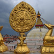 Golden brahma symbol in front of Boudha Nath (Bodhnath) stupa in — Stock Photo #25389141