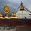 Golden brahma symbol in front of Boudha Nath (Bodhnath) stupa in — Stock Photo #25389759