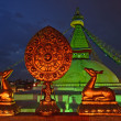 Golden brahma symbol in front of Boudha Nath (Bodhnath) stupa in — Stock Photo #25389967