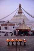 Sacred candles in front of Boudha Nath (Bodhnath) stupa in kathm — Stockfoto