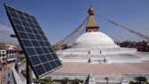 Solar cell above roof top of restaurant near Bodhnath Stupa in — Stock Photo