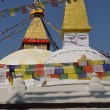 Boudhanath Stupa. Golden spire and all seeing Buddha eyes on top — Stock Photo #25391639