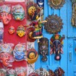 Masks, pottery,souvenirs, hanging in front of the shop on swayam — Stock Photo