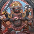 Statue of hindu deity Shivin form of fearful Bhairab on Du — Stock Photo #25392371