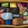 Colorful silk neck ties collection in wood basket. — Stock Photo #25392467