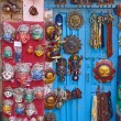Постер, плакат: Masks pottery souvenirs hanging in front of the shop on swayam