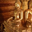 There are four small statues of Buddha in the temple Phumin Nan, — Stock Photo #25394687