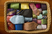 Colorful silk neck ties collection in wood basket. — Stock Photo